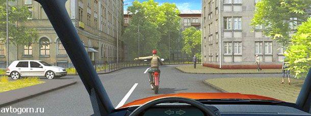 Такой сигнал рукой, подаваемый водителем мотоцикла, информирует Вас