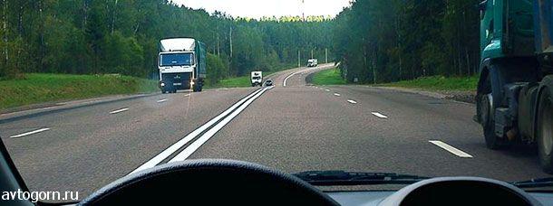 Можно ли Вам после опережения грузового автомобиля продолжить движение по левой полосе вне населенных пунктов